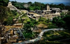 The Maya ruins of Palenque, are dramatically situated at the foot of the northernmost hills of the Chiapas highlands in Mexico