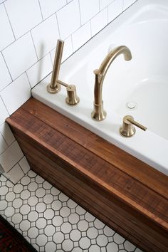 An easy tutorial on How to Install Wood Planking on a Bathtub to give your bathroom a spa like feel while keeping your wood protected! Wood Tub, Wood Bathtub, Wood Plank Tile, Diy Bathtub, Wood Bathroom, Wood Planks, Small Bathroom, Bathroom Ideas, Ceramic Tile Bathrooms