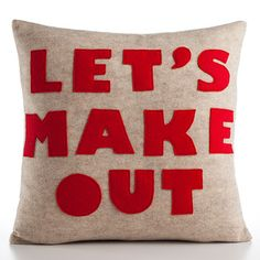 Alexandra Ferguson: Let's Make Out Oatmeal Red. She has the best pillows!  love her little messages.
