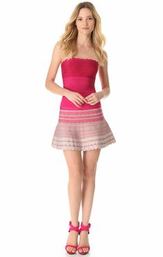 Herve Leger Fuschia Ombre Scalloped Strapless A Line Dress.* Scalloped bandage knit widens and tapers to create hourglass shape * Straight,strapless neckline * Fitted through hip * Formfitting through hip * Flouncy skirt * Hem hits above knee * Back zip * Rayon/nylon/spandex * Available in white,black,red,yellow,nude