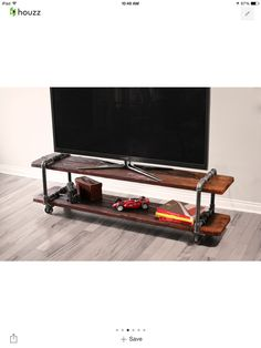 TV stand made of galvanized pipe nipples and tees.