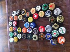 Initial decorated with beer caps with chris's initial for 21st bday