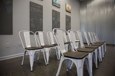 Metal Farmhouse Chairs: White metal and wood seats to balance the industrial theme. #diy #affordablebuilding #gonsteadchiro #industrial