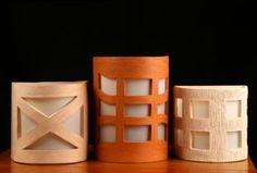 luminarias de pared hechas artesanalmente de cerámica.