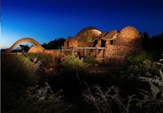 Mapungubwe Interpretation Centre, Limpopo, South Africa by Peter Rich Architects. Night View. Photo: AKAA / Obie Oberholzer
