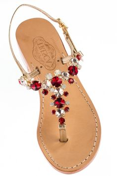 """Vita is a rich, red, milky and clear stoned sandal with gold Italian leather straps. Our soles are European sizes made in Italy. They are made from Italian leather with a wrapped, wooden heel. Please consult the size guide. If you're a half size, size up. All of our Italian sandals are handmade to order by our cobbler in store. We keep true to the Capri sandal by using nails not glue. We offer a 1/2"""" flat as well as a 1"""" heel.Because each is unique and made-to-order, please allow up to 5…"""