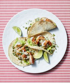 Who needs sour cream, when you can top fresh shrimp tacos with a simple (all you need is avocado, lime juice, and salt) yet flavor-packed guacamole cream instead? An olive salsa (yes, really!) adds zest and salt to each and every bite.