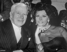 Charles Chaplin at Savoy Hotel press conference with Sophia Loren to announce Loren will costar with Brando in picture Chaplin will direct.