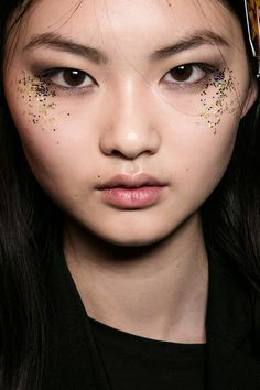 Push the boundaries of black liner and dark lipstick, play with peach tones and change the way you do glitter.