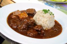 Goulash With Dumplings - Traditional German Food Stock Photo . Traditional German Food, Kefir Benefits, Kefir Recipes, Tonkatsu, Borscht, Goulash, Clam Chowder, Slow Food, Original Recipe