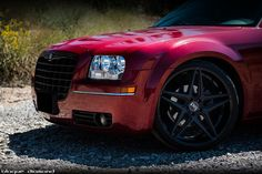 Inferno Red 2010 Chrysler 300 with Matte Back Grill and Blaque Diamond BD-8 rims…
