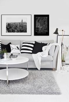 Black and white interior design. Art on wall above a couch. www.desenio.se