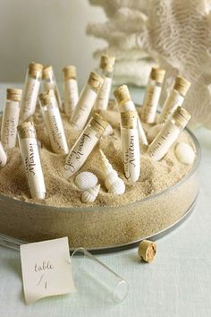 Letters in little Bottles – find your name, pull out message, it says your table placement! cute for beach