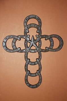 Lone Star cross is 7 x There is a bracket on back for hanging . The horse shoe wall hooks are 2 x 3 Material: Cast Iron. These are lovely and rustic. Horseshoe Projects, Horseshoe Crafts, Horseshoe Art, Horseshoe Ideas, Horseshoe Decorations, Horse Decorations, Horseshoe Wedding, Horseshoe Necklace, Lucky Horseshoe