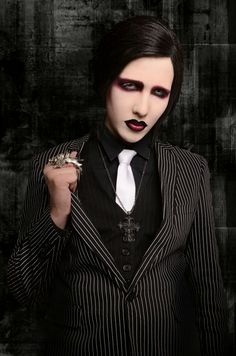 MARILYN MANSON -  (born January 5, 1969), better known by the stage name Marilyn Manson, is an American singer, songwriter, musician, composer, actor, painter, author and former music journalist. He is known for his controversial stage personality and image as the lead singer of the band Marilyn Manson