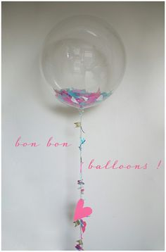 Clear confetti balloons ~ IDEA: Use 2 clear, round balloons, one smaller inside the other ~ FILL with confetti & glitter & insert a glow stick & partially inflate the innermost balloon