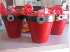 Santa Cup - Cute idea: A Red Solo Cup with electrical tape with a washer hot glued on (and of course filled with holiday treats!)
