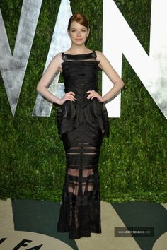 Something about this dress on Emma really works.  Classic yet modern..Chanel gets it right with this beautiful black gown.