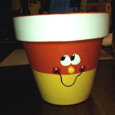 Cute! Lesson on planting during halloween time and make these pots to plant in!?