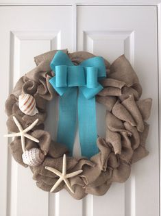 18 inch burlap wreath with aqua blue burlap ribbon and seashells and starfish on Etsy, $40.00