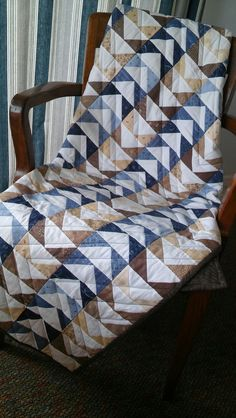 Flying geese pattern, hand pieced, machine quilted