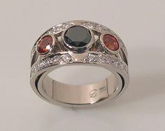 oh my, how much I want this ring from Petri...black diamond and orange sapphire