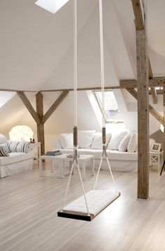 And if you trick out your basement, you've got to remodel your attic, too! What's more Pinterest-worthy than an airy greige room complete with a swing?