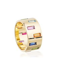 Hattie Rickards Kinetic Tube ring in yellow gold, set with rubies, sapphires and garnets (£5,750).