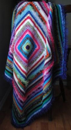 colorful blanket! use up all my mixmatched yarn! made from all different weights and types...perfect!