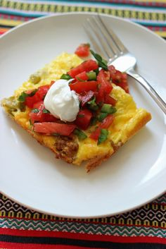 Spicy Turkey Egg Bake - Turkey spiced with spices and chiles is enrobed in a creamy egg mixture. This egg bake is perfect for holiday brunch...