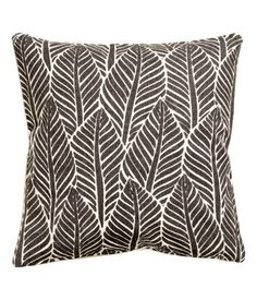 Charcoal gray. Cushion cover in cotton fabric with a printed leaf pattern at front and solid-color back section. Concealed zip.
