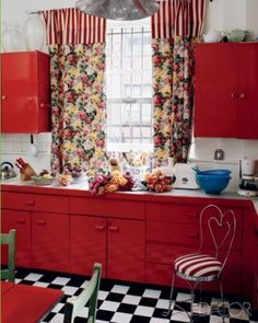 "Designer Lorraine Kirke painted the metal kitchen cabinets in her family's apartment near New York City's Washington Square ""Valentine's Day-red"" to contrast with the checkerboard floor. Red And White Kitchen, Red Kitchen, Kitchen Decor, Kitchen Ideas, Kitchen Stuff, Kitchen Inspiration, Kitchen Designs, Vintage Kitchen, Happy Kitchen"