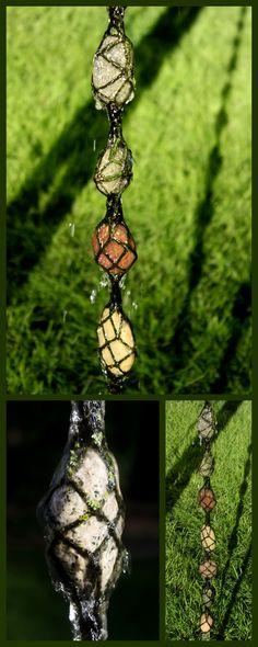 stone rain chain made of yarn macraméd around found river rocks