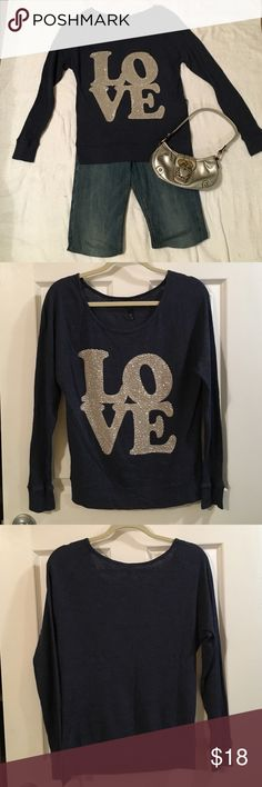 "Blue ""LOVE"" top Blue ""LOVE"" top. Love detail has beading. Ribbed long sleeve shirt. Love culture size small. 50% cotton 50% polyester. Love Culture Tops Tees - Long Sleeve"