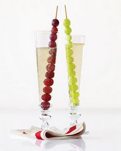 """Simple way to incorporate fruit into your drinks - grapes on kabobs! Because of grapes high water content, they are easily frozen and make great """"ice"""" too!"""