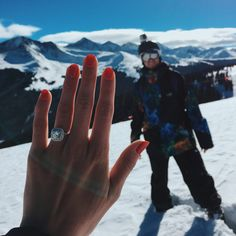 This halo engagement ring is so stunning, and the way he proposed in the mountains was a perfect surprise.