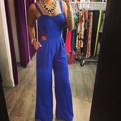 Cobalt-blue jumpsuit with cut-out sides