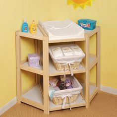 Corner baby changing table - why didn't I think of this!  Makes so much more sense than standing sideways!  Who's having a baby next?