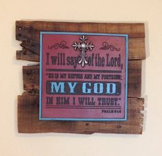"""Medium wooden pallet plaque. The reclaimed pallet boards are stained with a dark danish oil and then topped with a wall sign with the Psalm 91:2 scripture on it:  I will say of the Lord, """"He is my refuge and my fortress; My God, in Him I will Trust.""""  The wall sign also features an ornate silver cross accent featuring a silver rhinestone in the center. Dimensions are approximately 10"""" x 12"""". Each cross is handmade with love and truly one of a kind."""
