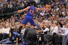 New York's Jeremy Lin leaps to try and save a ball from going out of bounds in the first half during the Dallas Mavericks vs. the New York Knicks NBA basketball game at American Airlines Center in Dallas on Tuesday, March 6, 2012.