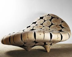 A unique take on a chaise lounge, made of pine.