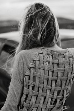 weave the back of an old sweatshirt. Such a creative idea. love.