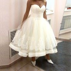 Item Type: Wedding Dresses Sleeve Style: Off the Shoulder Silhouette: A-Line Built-in Bra: Yes Decoration: Pleat,Appliques Back Design: Lace Up Sleeve Length: Sleeveless Train: None is_customized: Yes