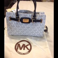 Michael kors large Hamilton navy blue monogram Brand new still has stuffing inside , comes with dust bag . Shoulder strap and short straps . MICHAEL Michael Kors Bags