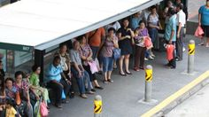 File photo: People waiting at a bus stop. (Photo: Hester Tan, channelnewsasia.com) ▼12May2014ChannelNewsAsia|Three new bus services to link heartlands to CBD http://cna.asia/1lo9C1L #Singapore