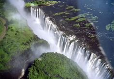 Victoria Falls in Africa ~ If you're going to see a waterfall might as well make it the largest. Breath-taking, I'm sure. Oh The Places You'll Go, Great Places, Places To Travel, Amazing Places, Visit Victoria, Victoria Falls, Queen Victoria, Beautiful World, Beautiful Places