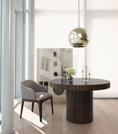 Enjoy the warmth of Brazilian wood or the elegance of high gloss lacquer. The Berkeley dining table represents clean, incisive design. The recessed pedestal base sits firmly underneath a solid round top. Brilliant painted glass adorns the surface creating a formal contemporary table. Seats 4-5 guests.