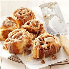 Hot homemade cinnamon rolls with a maple glaze are the perfect brunch recipe.  Filled with butter, brown sugar and pecans, these will be a favorite!