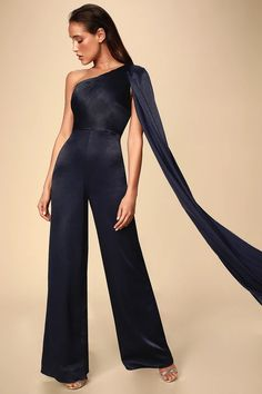 Slip on the Bariano Jane Navy Blue Satin Shoulder Cape One-Shoulder Jumpsuit and work the room! Chic satin one shoulder jumpsuit with a dramatic shoulder cape. Jumpsuit Prom Dress, Formal Jumpsuit, Cape Jumpsuit, Petite Jumpsuit, Satin Jumpsuit, Wedding Jumpsuit, Jumpsuit Shorts, Shoulder Cape, One Shoulder Jumpsuit