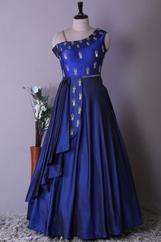 Make a smoky entrance in this regal persian blue color draped gown. Its a hit for fancy affairs from festives to royal weddings, it adds instant feminity to the draped silhouette, while the glinting glance make it a versatile option that will leave a last Kids Party Wear Dresses, Gown Party Wear, Dresses Kids Girl, Girls, Long Dress Design, Stylish Dress Designs, Stylish Dresses, Long Gown Dress, Saree Dress